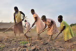 Mary Anyango (left), and her daughters (left to right) Joice, Nyanasek and Aloi Majak, join other members of the United Methodist Women in Yei, Southern Sudan, to prepare a plot of land for planting vegetables as part of a group food security project. Many of them widows, the women live precariously but at peace after having returned from refugee camps in neighboring Uganda and the Congo in recent years. A 2005 Comprehensive Peace Agreement laid the foundations for peace in Sudan's south after decades of war. NOTE: In July 2011, Southern Sudan became the independent country of South Sudan