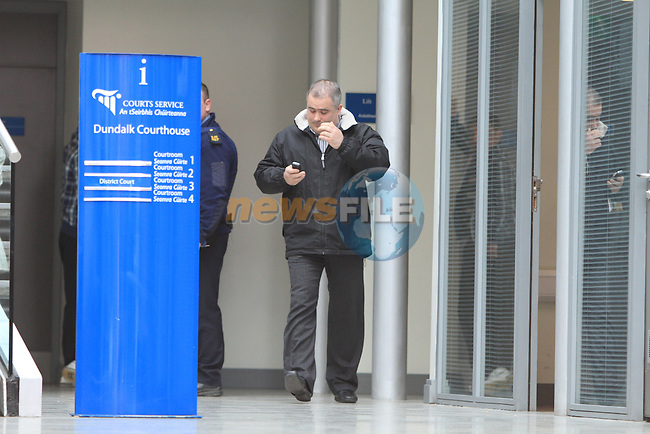 Dermot McArdle leaves court no 3 at Dundalk Court, After his case for aleaged assault against a female photographer was set for July...Picture Fran Caffrey/Newsfile.ie