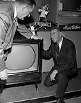 Pittsburgh PA:  Hamburg Brothers Salesman demonstrating the new RCA Color Television.  During the 50's and 60's, Hamburg was a wholesale  appliance distributor and also sold directly to the public.<br />