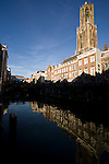 The DOM tower in Utrecht, the Netherlands reflected in a Oudegracht Canal.