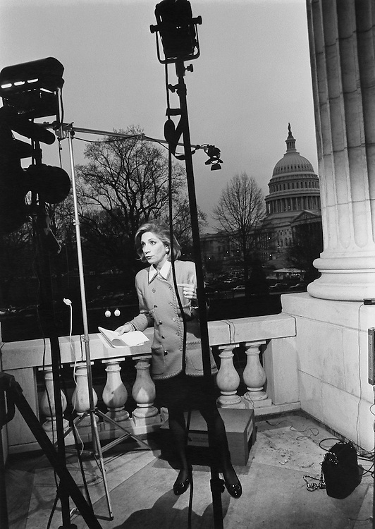 Hill press in action. NBC's Andrea Mitchell doing a newstake on Russell overlooking the Capitol. March 19, 1991 (Photo by Maureen Keating/CQ Roll Call)