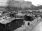 Pittsburgh PA:  Looking south toward the Pennsylvania Railroad's Union Station - the Strip District of Pittsburgh 1930.   During the depression, the area from the PA RR Station to the 17th street bridge was called Shantytown.  Father Cox, a local priest, helped the residents through food kitchens and highlighting their plight.  Brady Stewart photographed the area for the City of Pittsburgh.