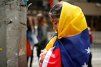 A child is covered with the flag while Venezuela's government opposition members take part in a rally against president Maduro and his government in front of Venezuela's consulate in New York,  04/19/2015. Eduardo MunozAlvarez/VIEWpress