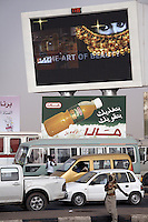 Giant screens line Khartoum's main transport route near the city's airport, Sudan, on Wednesday, Apr. 11, 2007..Khartoum is modeling itself as the Dubai of Africa and despite Western sanctions the city is booming. Away from the troubles and poverty that plaque the rest of Sudan, development in Khartoum is moving at an astonishing rate. Investment from the East, and in particular China, allowed the Sudanese economy to grow by 11% in 2007. This growth is driven largely by oil, with production rising from 63,000 barrels per day in 1999 to over 500,000 barrels today.