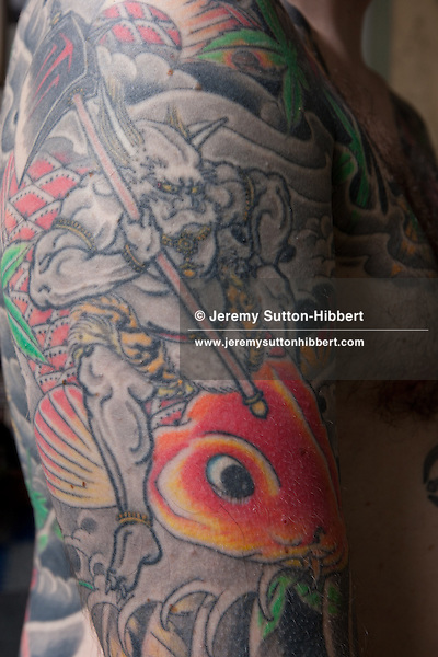 tattoo artist Horiyoshi III, shows his full body suit of tattoos