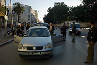 Tunis, January 16, 2011.Inhabitants from Le Belvédère neighborhood set up barricades and check points across their streets to control cars and passers' by  to prevent militias or looters to enter the area. These 'vigilante' groups can be seen all over Tunis.