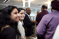 Ashok Alexzander shares a light moment with staff and guests after the puja (prayer and blessing) ceremony at the opening of the new Bill &amp; Melinda Gates Foundation office in New Delhi, India on 17th December 2010. Photo by Suzanne Lee for Gates Foundation