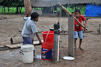 Yuracare children pumping water from a well in Villa Hermosa, near San Lorenzo, Beni, Bolivia