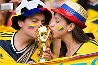 Columbia fans kiss a fake world cup trophy