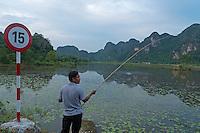 Ninh Binh, man fishing at a small Pond. Vietnam