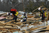 Search and rescue workers are seen in Waveland Ms. following Hurricane Katrina, Aug. 31,2005.