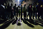 Refugees and migrants line up for food after dark in the city park on the Greek island of Chios. The park is full of tents sheltering refugees who crossed the Aegean Sea in small boats from Turkey. They were registered and provided with food and shelter in a reception center built with support from International Orthodox Christian Charities, a member of the ACT Alliance. Many of them then move to the city park where they await a ferry to take them to Athens and then on toward western Europe. Hundreds of thousands of refugees and migrants have passed through Greece in 2015.