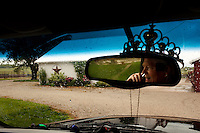 Wellsville, Kansas, May 28, 2011 - A tiarra sits atop the rear view mirror in the truck of fourth generation family farmer Robin Dunn at her farm, Dunn's Landing. ..Dunn bought her great grandparents homestead from her father in 1993, and today grows soybeans, corn, sorghum and hay, and maintains a small herd of Black Angus cattle and eight horses which she uses to for wagon and stage coach rides.  According to the most recent Department of Agriculture data, there are more than 306,000 farms run primarily by women in 2007, representing about 14 percent out of the 3.3 million American farms.  That's up from 237,819 or 11 percent in 2002, and a big increase from the 1980s when about five percent of U.S. farms were operated by women.Dunn has branched out from her farming business, using her century-old dairy barn to host 25 to 30 weddings and other events a year. She also attracts tourists for farm tours and carriage rides, and holds sessions with school children to teach them about faming.