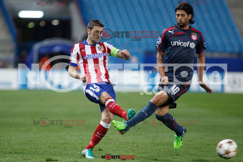 Atletico de Madrid´s Gabi (L) and Olympiacos´s Alejandro Dominguez during Champions League soccer match between Atletico de Madrid and Olympiacos at Vicente Calderon stadium in Madrid, Spain. November 26, 2014. (ALTERPHOTOS/Victor Blanco) /NortePhoto