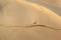 Aerial view of sand dunes at Dunhuang in Gansu Province, China. Desertification is the process by which fertile land becomes desert, typically as a result of drought, deforestation, or inappropriate agriculture. 41 % of China's landmass in classified as arid or desert. Innapropriate farming methods and overcultivation have contributed to the spreading of deserts in China in recent years.