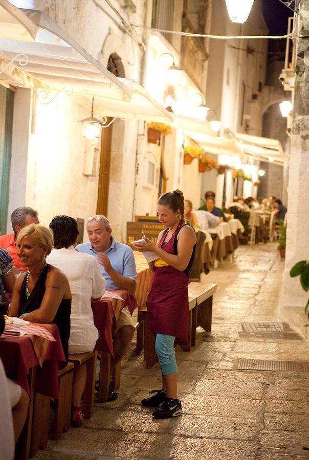 Waitress taking dinner order in Puglia, Italy