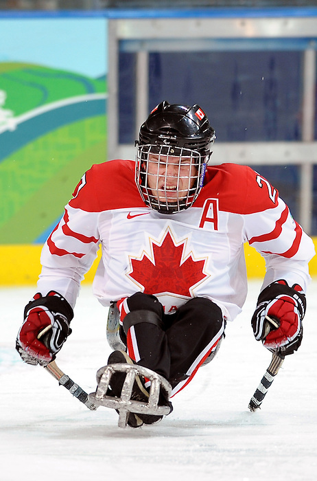 Bradley Bowden (27) skates for the puck during the 2010 Paralympic Games, bronze medal sledge hockey game at UBC Thunderbird Arena in Vancouver. Credit: CPC/HC/Matthew Manor.