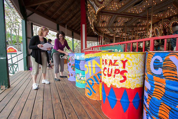 MIDDLEBURY, CT - 09 APRIL 2015 - 050915JW08.jpg -- North End Middle School art teacher June Kozloski and Swift Middle School art teacher Stephanie Goetz judge Quassy Amusement Park garbage cans painted by children from local elementary schools Saturday afternoon at the park. Jonathan Wilcox Republican-American