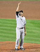 New York Yankees pitcher Luis Ayala (38) points to a pop-up as he pitches against the Baltimore Orioles at Oriole Park at Camden Yards in Baltimore, MD on Friday, August 26, 2011.  The Orioles won the game 12 - 5..Credit: Ron Sachs / CNP.(RESTRICTION: NO New York or New Jersey Newspapers or newspapers within a 75 mile radius of New York City)