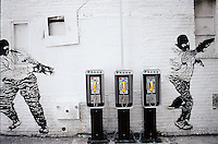 A bank of public phones in NoLIta/SoHo, Prince Street with a mural (artist unknown). 1996