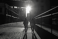 Sunset silhouettes on a DUMBO, Brooklyn cobbled street