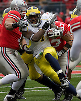 November 22, 2008. Michigan running back Brandon Minor fights for yardage.  The Ohio State Buckeyes defeated the Michigan Wolverines 42-7 on November 22, 2008 at Ohio Stadium, Columbus, Ohio.