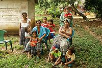 Several generations of Q'eqchi Maya women and children, Candelaria Caves, Alta Verapaz, Guatemala.