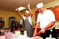 NWA Democrat-Gazette/ FLIP PUTTHOFF<br /> ICE CREAM TREATS<br /> Ken Dickerson (left) beckons people to come for some ice cream while Charles Riggs dishes up the treat on Saturday June 13 2015 during an ice-cream social fundraiser at Unity Church of the Ozarks in Bentonville. The social had a 1950s theme and raised funds for the church, said Claudia Lawson, church member. Art items made by church members were sold in a silent auction to benefit the church, located at 902 S.W. 2nd St.