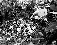 The Tapel Massacre on 1 July 1945.  Picture shows Pedro Cerono, the man who discovered the group of 8 skulls.  Tapel, Cagayan Province, Luzon, Philippine Islands.  November 23, 1945.  T5c. Lewis D. Klein.  (Army)<br /> NARA FILE #:  111-SC-227909<br /> WAR &amp; CONFLICT BOOK #:  1250