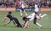 Colorado Rapids defender Kosuke Kimura (27) fouls DC United midfielder Chris Pontius in the area to award DC United a penalty kick to tie the game.  DC United tied The Colorado Rapids 1-1, at RFK Stadium, Saturday  May 14, 2011.