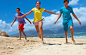 Teens running on beach at Kanaha Beach Park, Kahului, Maui
