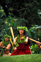 Woman with puili at Prince Lot hula festival performance at Moanalua gardens, Oahu