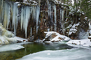 The Lower Pool at Sabbaday Falls in Waterville Valley, New Hampshire USA during the winter months. These falls are located off the Kancamagus Highway in the White Mountains.
