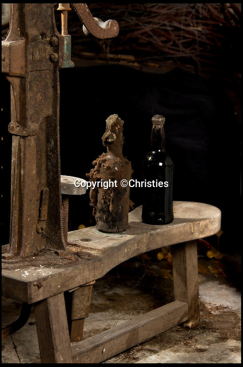 BNPS.co.uk (01202 558833)<br /> Pic: Christies/BNPS<br /> <br /> ***Please Use Full Byline***<br /> <br /> Two bottles of rum.<br /> <br /> Sixteen mouldy bottles of the world's oldest rum have sold for a whopping &pound;135,000 after they were discovered in the cellars of an British stately home.<br /> <br /> The rum was made in Barbados 235 years ago then brought back to Britain, where it was a popular spirit in Georgian times, by aristocrat Henry Lascelles, the Earl of Harewood.<br /> <br /> Amazingly the dust-covered bottles were only discovered in 2011, when Mark Lascelles, brother of the eighth Earl of Harewood, performed a stock check at the Grade II-listed property in Leeds.<br /> <br /> The sale means each bottle of rum is worth &pound;8,482, making it not only the oldest but also the most expensive rum in the world.