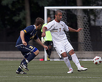 Boston College forward/midfielder Amit Aburmad (7) passes the ball as Quinnipiac University forward Hakon Weloy Aarseth (3) closes. Boston College defeated Quinnipiac, 5-0, at Newton Soccer Field, September 1, 2011.