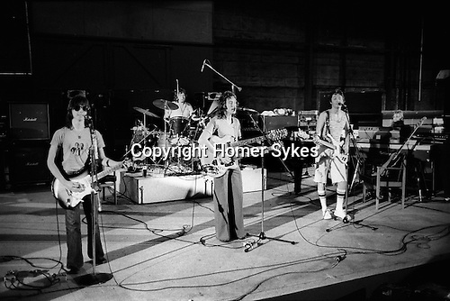 "Jimmy McCulloch Denny Laine  Joe English on drums, Paul, Linda Paul and Linda McCartney Wings Tour 1975.Elstree Studios rehearsal. The photographs from this set were taken in 1975. I was on tour with them for a children's ""Fact Book"". This book was called, The Facts about a Pop Group Featuring Wings. Introduced by Paul McCartney, published by G.Whizzard. They had recently recorded albums, Wildlife, Red Rose Speedway, Band on the Run and Venus and Mars. I believe it was the English leg of Wings Over the World tour. But as I recall they were promoting,  Band on the Run and Venus and Mars in particular."