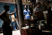 Customers wait for their tea next to a tea stall in Kinari bazaar of Chandni Chowk, in the old city of Shahjanabad, popularly known as Old Delhi.
