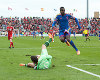 Toronto, Ontario - April 12, 2014: Colorado Rapids forward Edson Buddle #9 and Toronto FC goalkeeper Julio Cesar #30 in action during the 2nd half in a game between the Colorado Rapids and Toronto FC at BMO Field in Toronto.<br /> Colorado Rapids won 1-0.