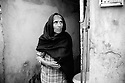 An elderly woman in her house in French colony slum.