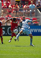 10 July 2010: Colorado Rapids forward Conor Casey #9 and Toronto FC defender Adrian Cann #12 in action during a game between the Colorado Rapids and Toronto FC at BMO Field in Toronto..Toronto FC won 1-0.
