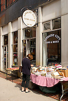 Woman looking at books outside a bookstore in the city of Saint John, New Brunswick, Canada