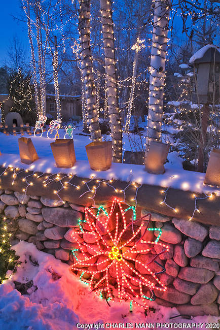 A yard filled with twinkling Christmas lights is part of the annual Christmas Eve celebration on Canyon Road in Santa Fe, New Mexico