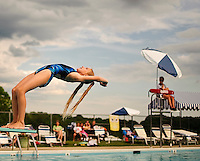 (staff photo by Matt Roth)..West Howard County diver Madelinn Small, age 9, from Woodbine, is doing a back dive straight position. Her final score was 55.55, placing her 3rd in the girls 8 and under during the dive meet between Five Oaks, from Catonsville, and host West Howard, in Mt. Airy, Thursday, July 9, 2009.