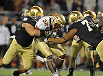 Manti Te'o (5) and Stephon Tuitt (7) sandwich Florida State running back James Wilder Jr. (32) in the first quarter.