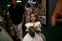 A young girl anxiously wait backstage for the results of the beauty pageant honoring Mr and Miss St. George.