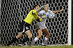 10 November 2012: Loyola Maryland's Colleen Folan (31) grabs the ball in front of Duke's Katie Trees (right). The Duke University Blue Devils played the Loyola University Maryland Greyhounds at Koskinen Stadium in Durham, North Carolina in a 2012 NCAA Division I Women's Soccer Tournament First Round game. Duke won the game 6-0.
