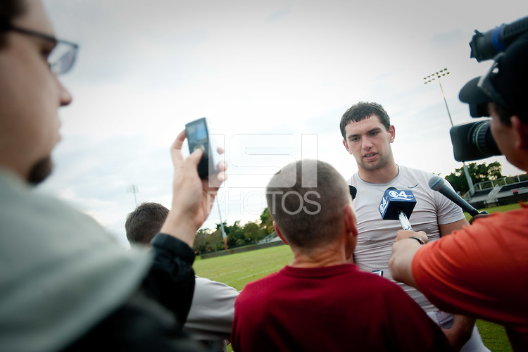 MIAMI, FL--Andrew Luck fields questions from the media after practice at Barry University in Miami, Florida.