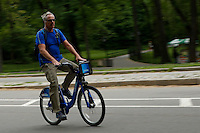 New York, USA. 28 May 2014. A man rides a Citi bike during the one year anniversary in New York. Photo by Eduardo Munoz Alvarez/VIEWpress