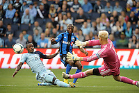 KANSAS CITY, KS - June 1, 2013:<br /> Sanna Nyassi (11) midfield Montreal Impact shot goes across the goal mouth.<br /> Montreal Impact defeated Sporting Kansas City 2-1 at Sporting Park.