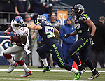 Seattle Seahawks  linebacker Brock Coyle (52) tackles New York Giants tight end Daniel Fells(85)  at CenturyLink Field in Seattle, Washington on November 9, 2014. The Seahawks  beat the Giants 38-17.     ©2014. Jim Bryant Photo. All rights Reserved.